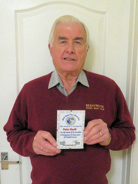 Peter Revill with his Life Membership Award