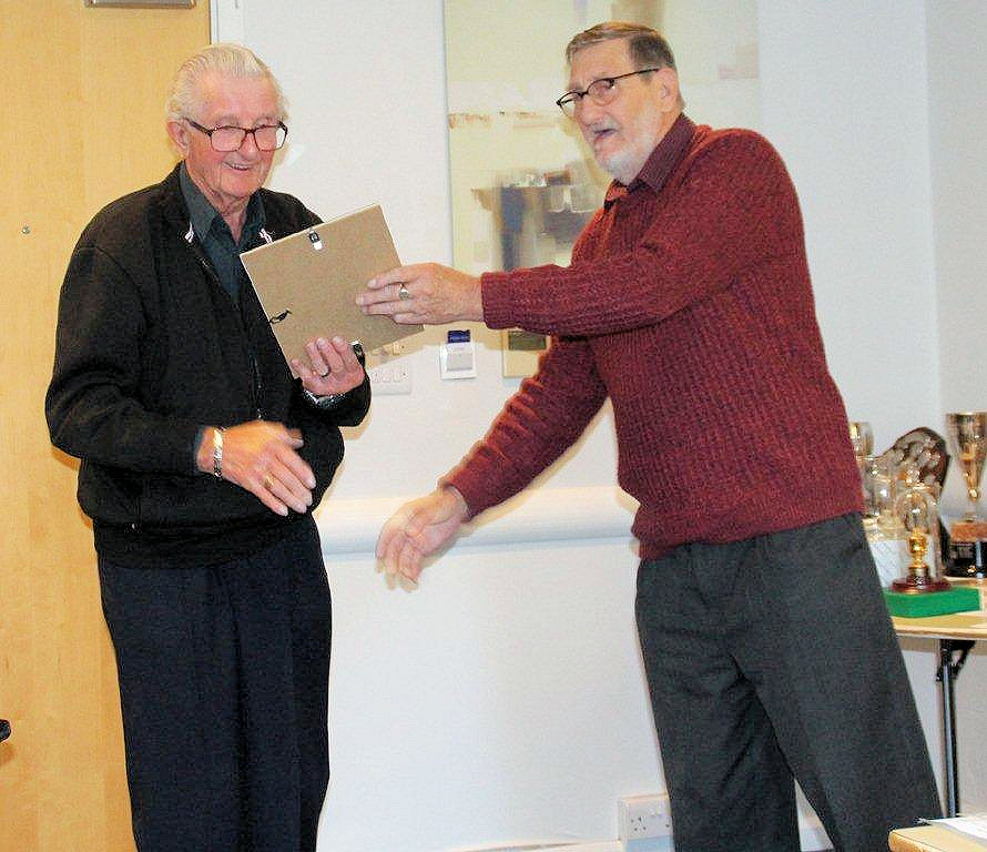 Arthur Wall receiving the Presidents award from Tony Willett