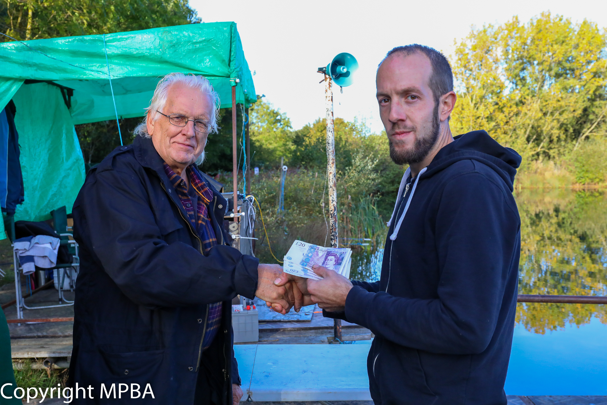 James collects his cash from Dave Marles